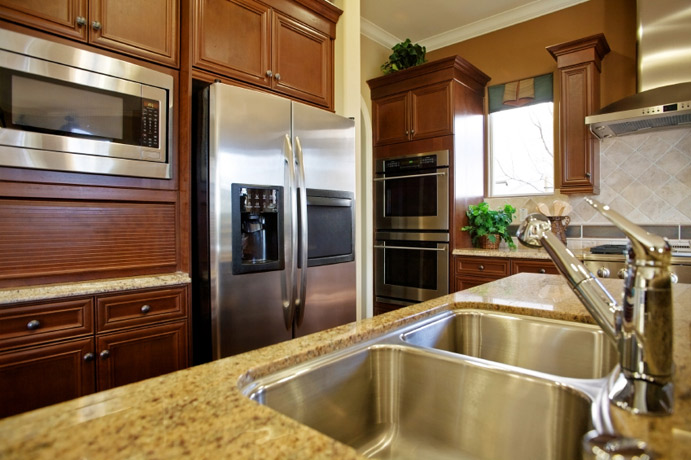Granite Kitchen Countertop tan mahogany cabinets